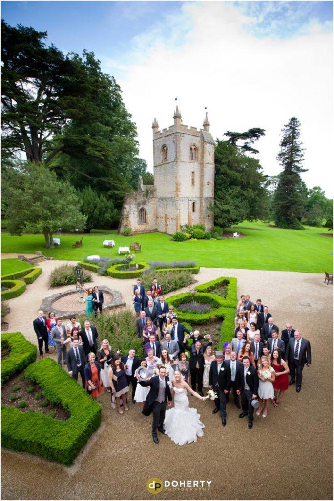Ettington Park Wedding Group photo with church in background