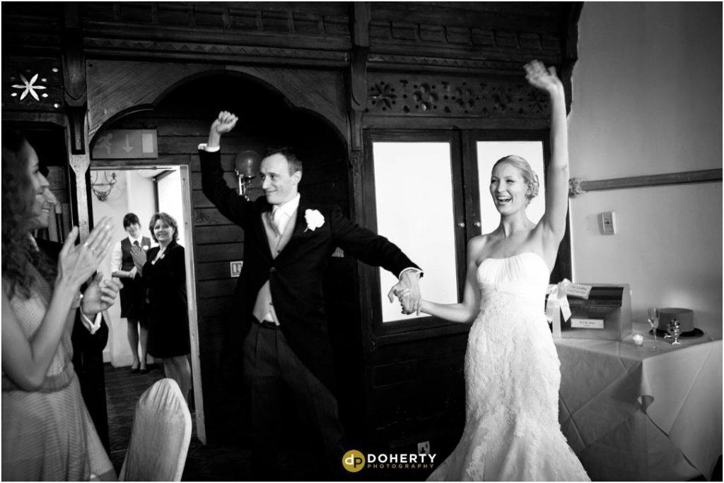 Ettington Park Bride and Groom big entrance in to room