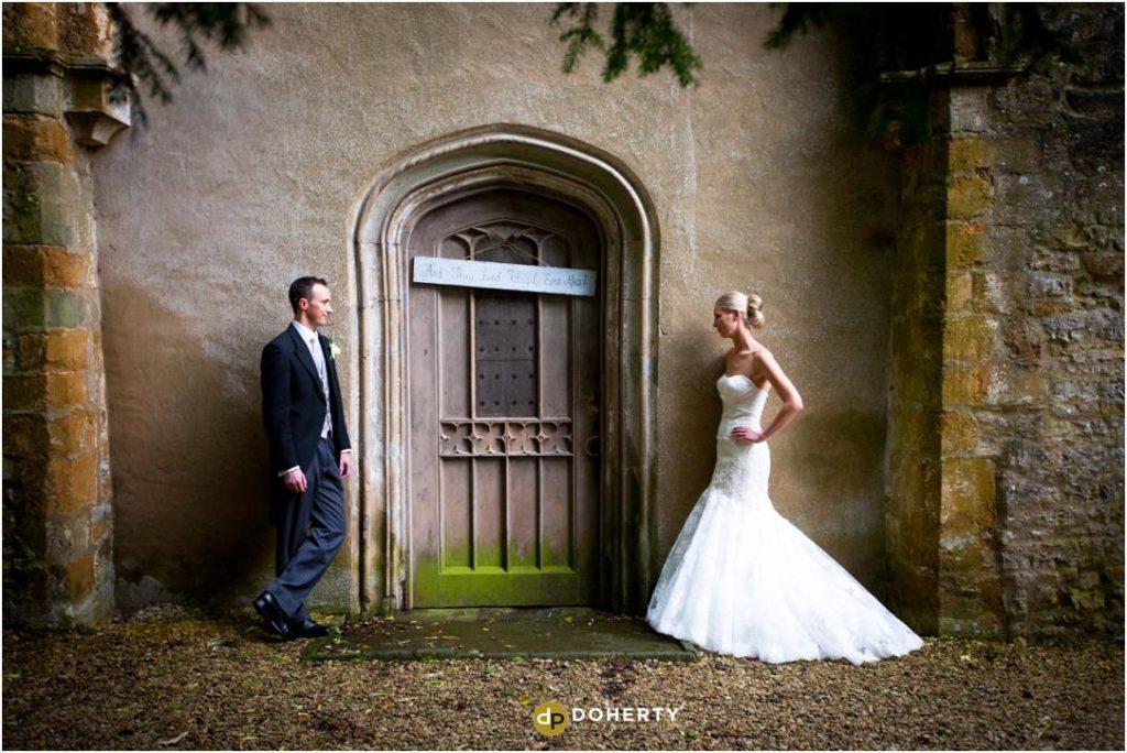 Ettington Park Wedding couple outside chapel