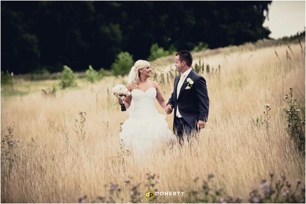Wedding Photography of bride and groom in fields - Marriott Forest of Arden