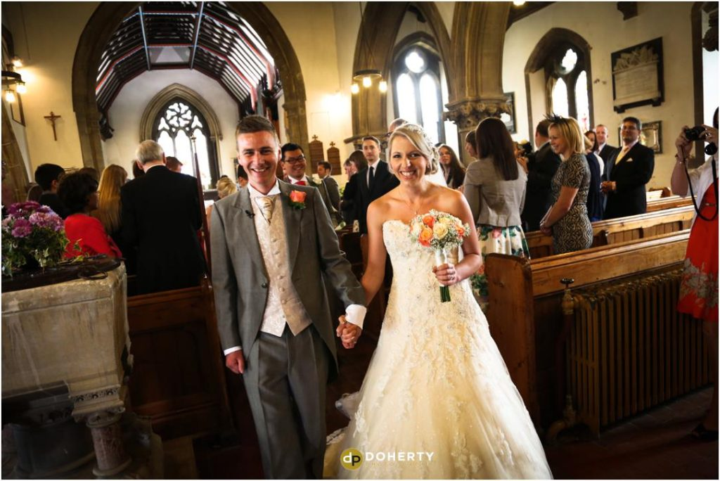 Bride and Groom walk back down the aisle at Church in Leicestershire