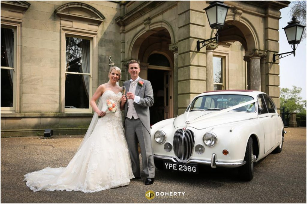 Wedding couple arrive in wedding car - Kilworth House