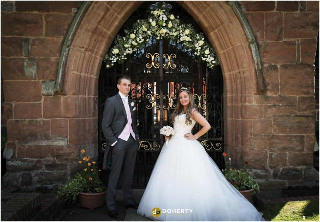 Church wedding outside with bride and groom
