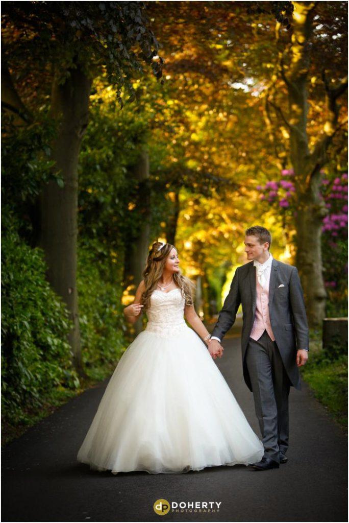 Nuthurst Grange - Bride and Groom walking down lane