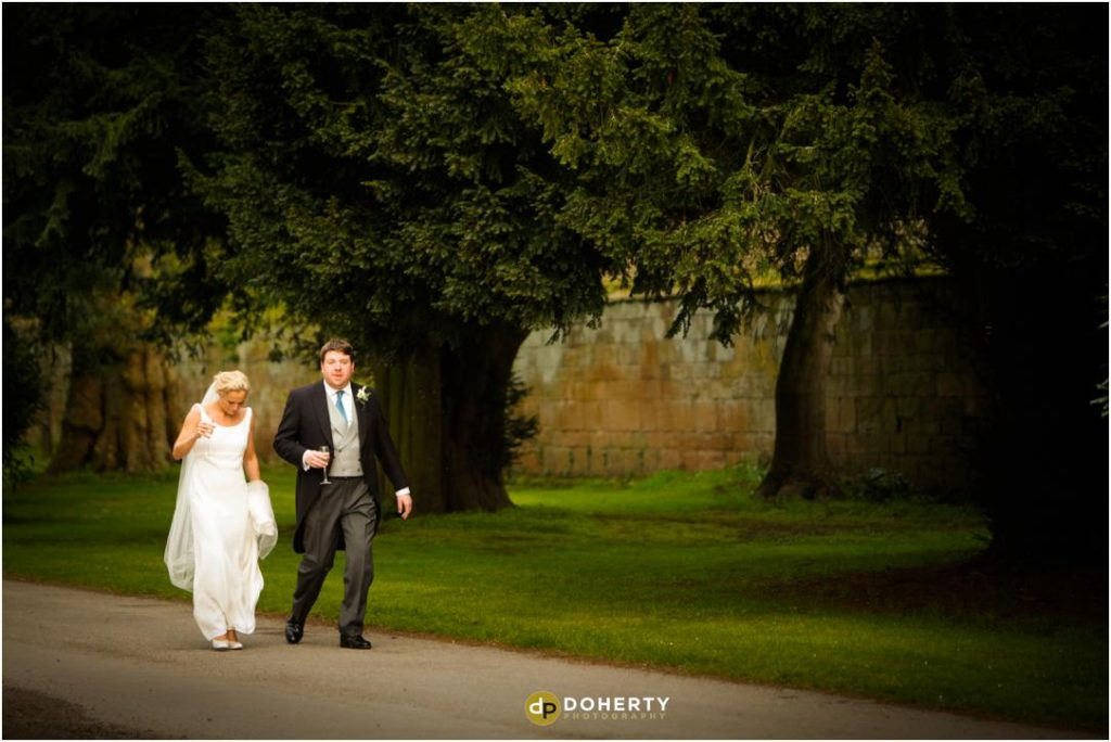 Bride and Groom walking at Stoneleigh Abbey Wedding