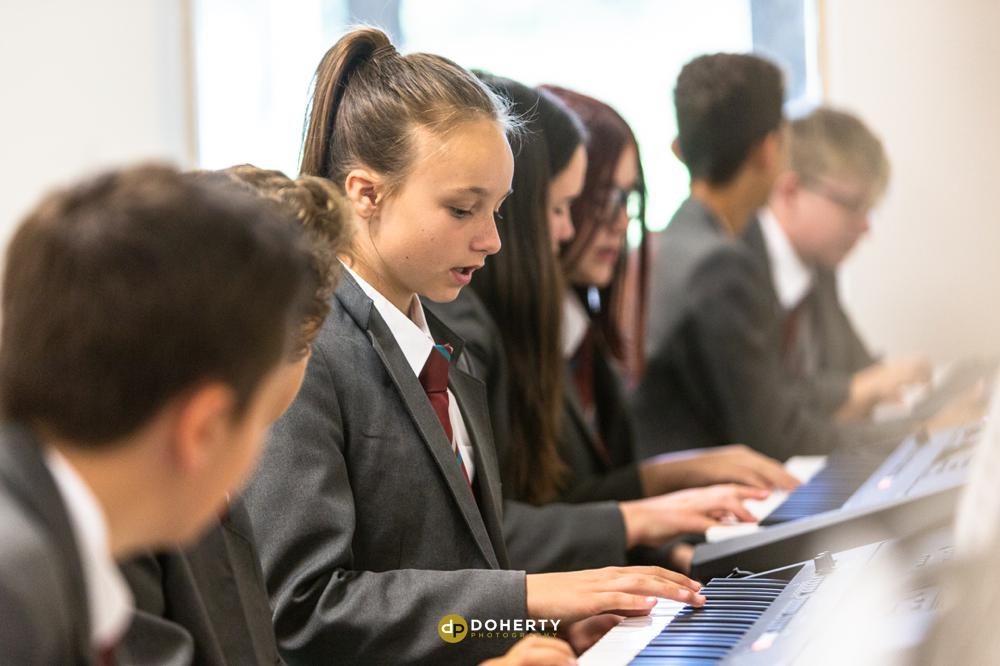 School Prospectus Photography - playing the piano