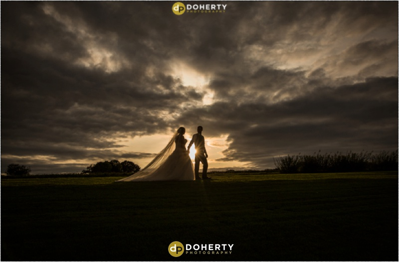 Wethele Manor wedding photo at sunset with bride and groom