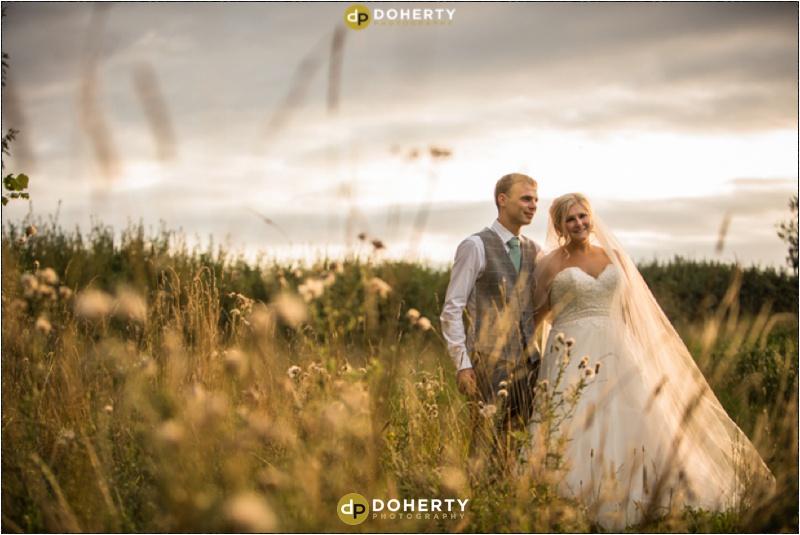 Wethele Manor wedding bride and groom in fields