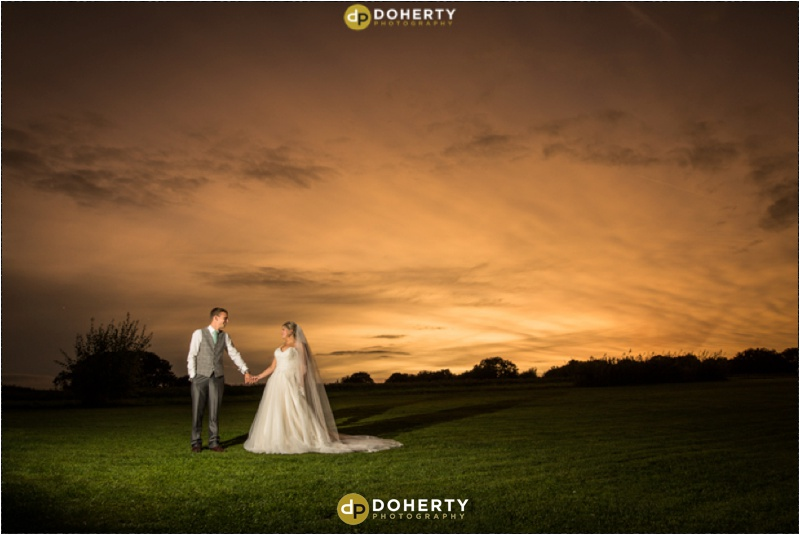 Bride and Groom with a beautiful sky backdrop