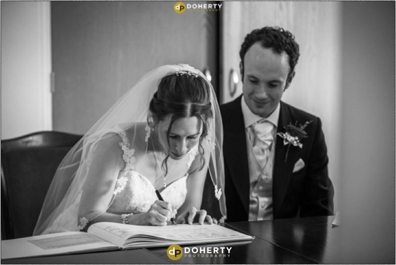 Bride and groom sign registrar