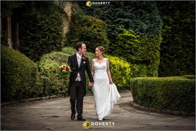 Coombe Abbey Wedding Venue Bride and Groom walking