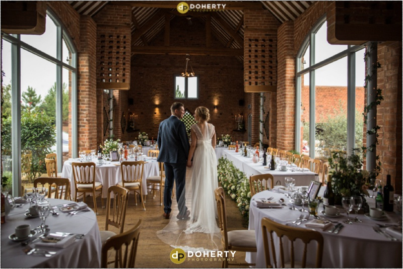 Swallows Nest Barn Wedding Venue with bride and groom