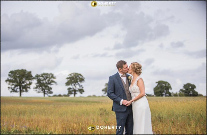 Swallows Nest Barn Wedding Bride and Groom in Field