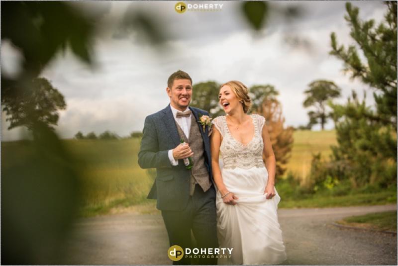 Swallows Nest Barn Wedding Bride and Groom Running