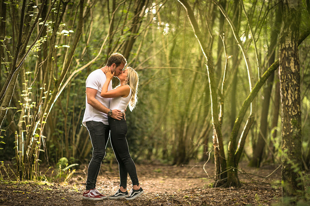 portrait in woods of couple