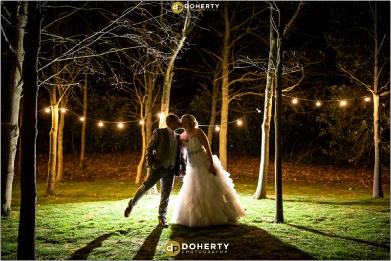 Wedding Couple with trees lit up - Shustoke Barn