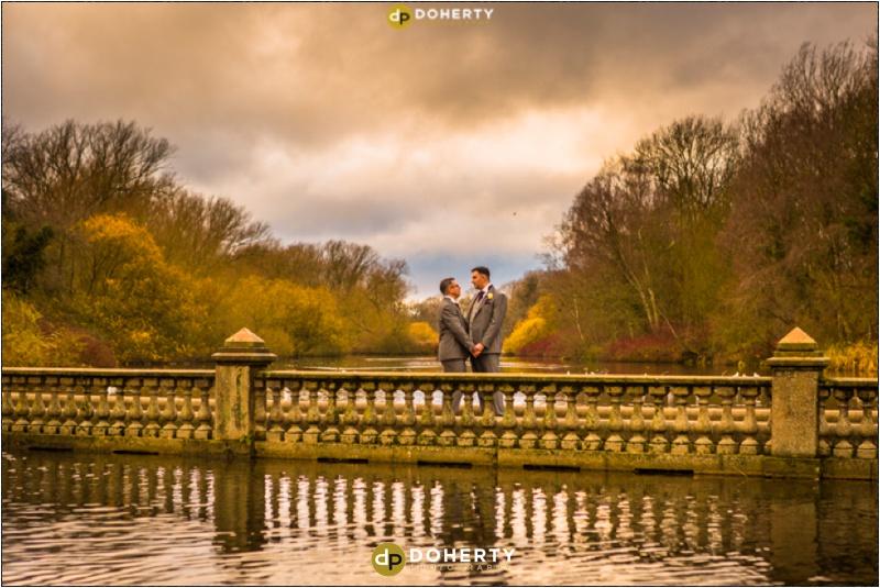 Coombe Abbey Same-Sex Wedding couple on bridge at lake