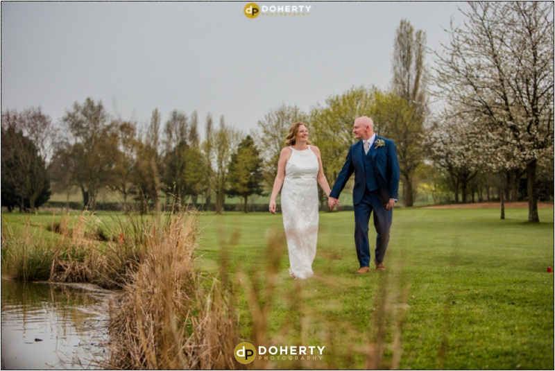 Windmill Village Bride and Groom Walking on Golf course