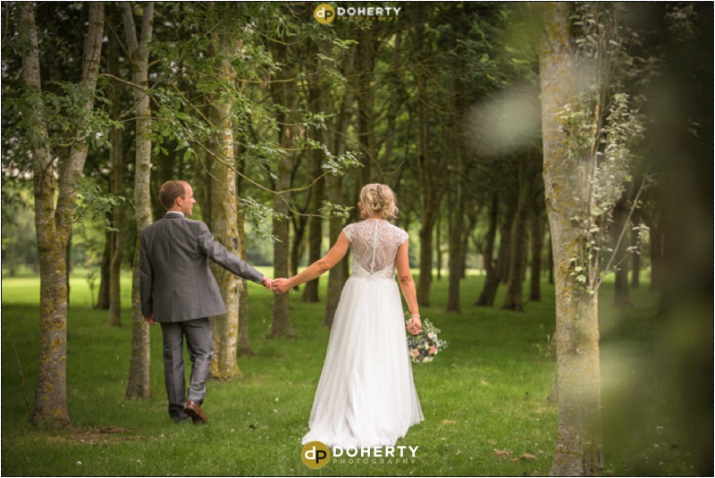 Stratford Park Hotel Wedding Bride and Groom Walking through woods