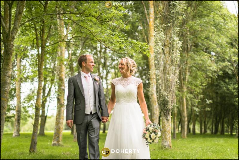 Stratford Park Hotel Bride and Groom Walking