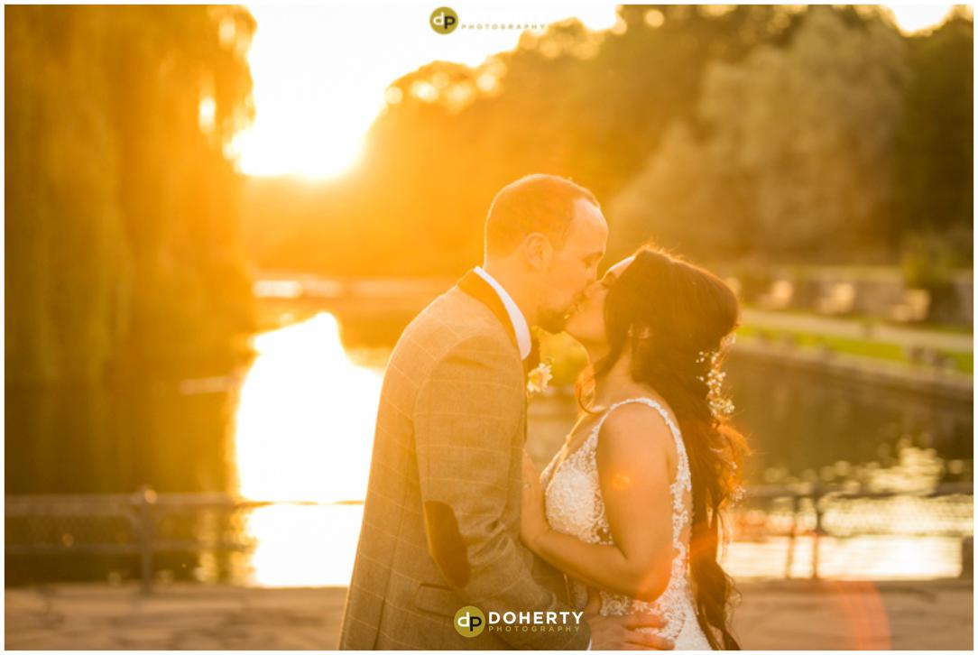 Coombe Abbey - Bride and Groom at Sunset by lake