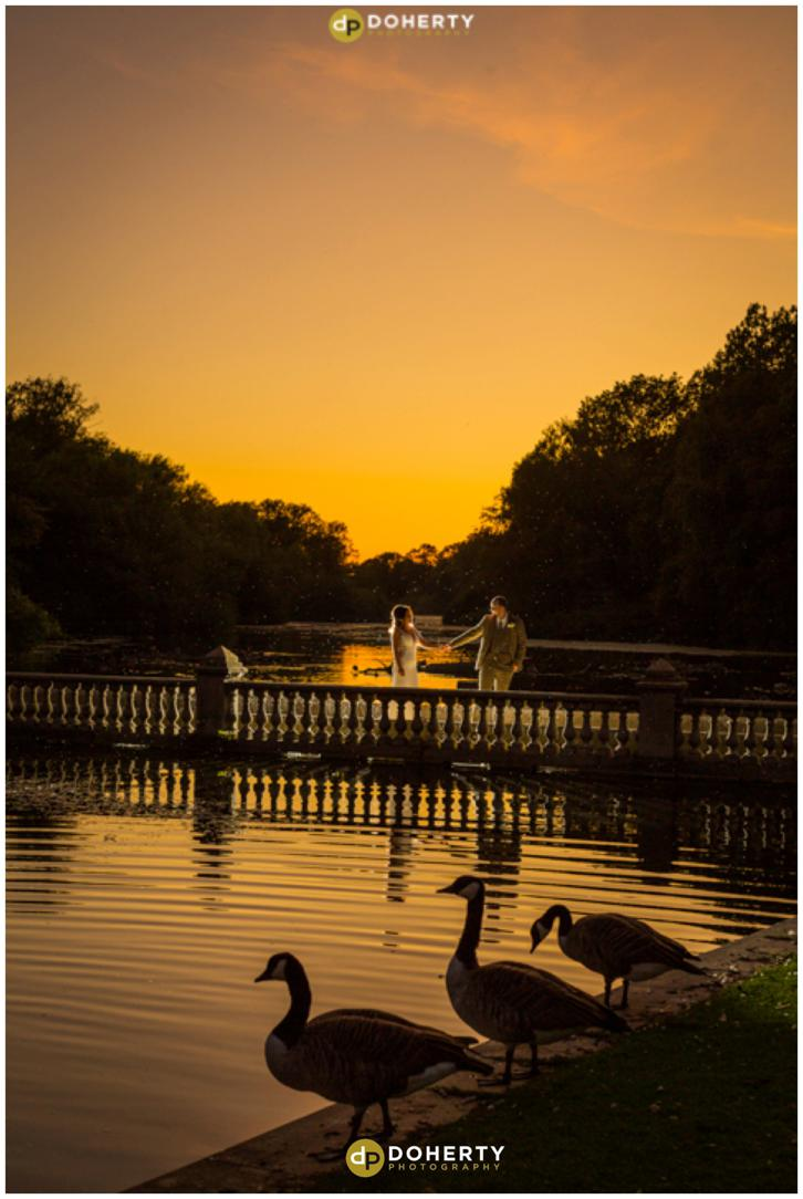 Coombe Abbey Wedding - Sunset photo by the lake with bride and groom