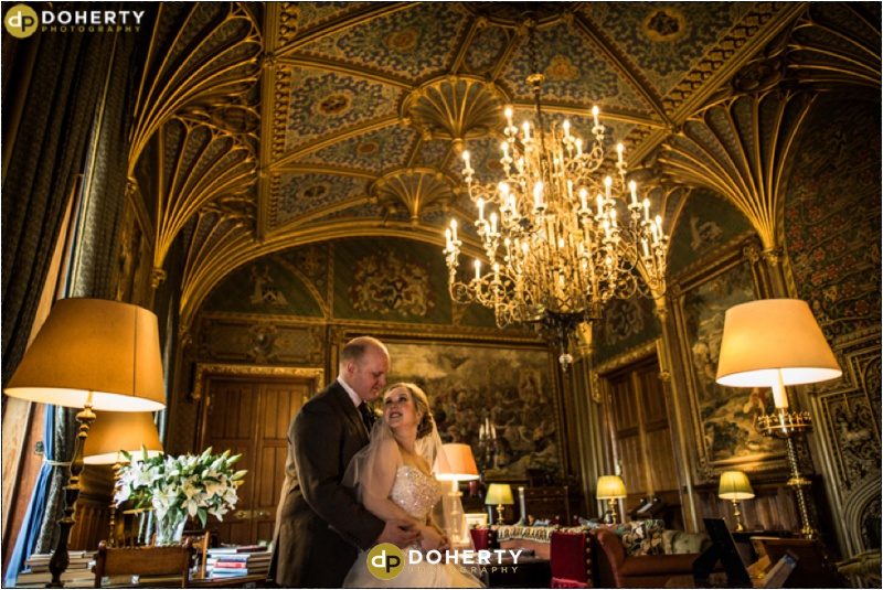 Eastnor Castle interior with bride and groom