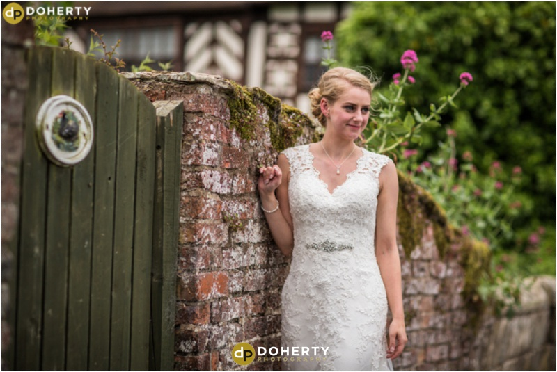 Albright Hussey Manor Bride by wall