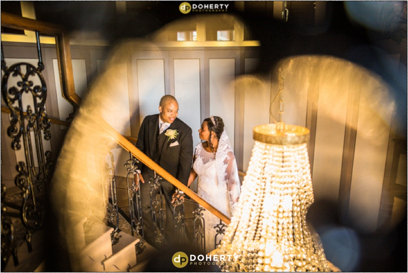 The Manor Hotel on staircase with bride an dgroom