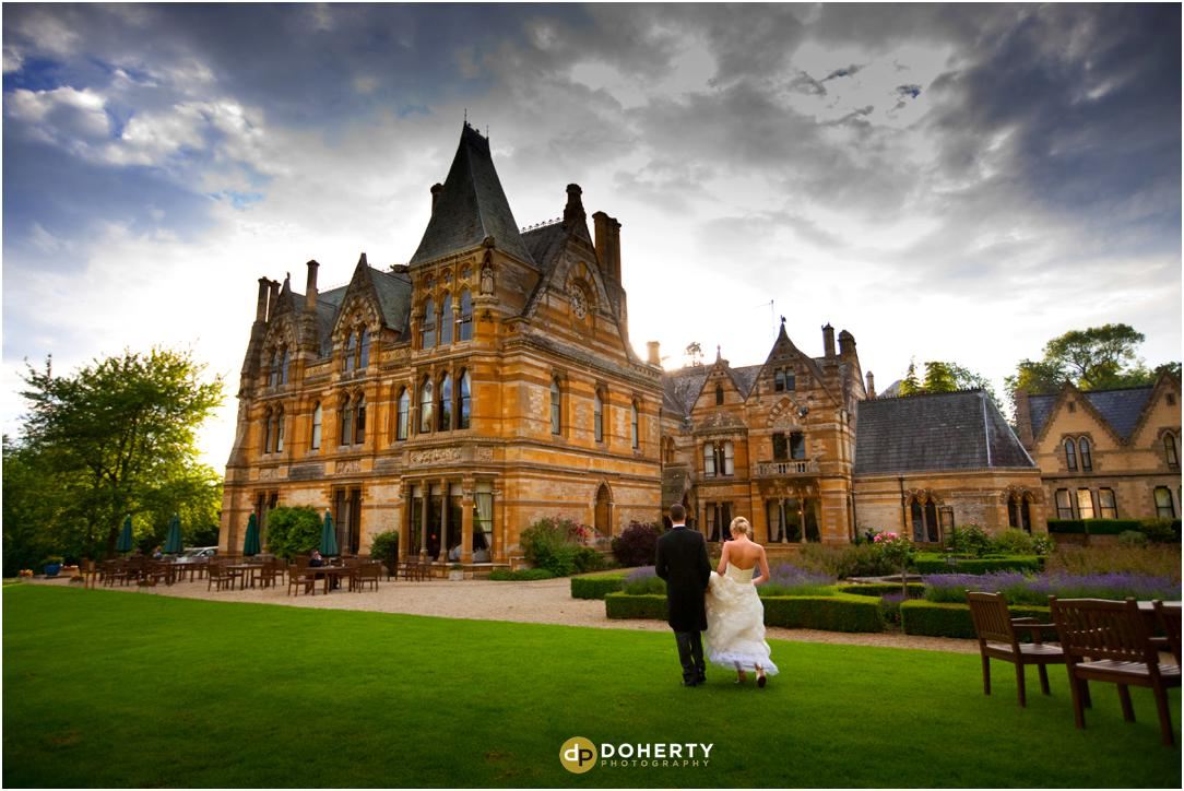 Ettington Park with bride and groom walking in grounds