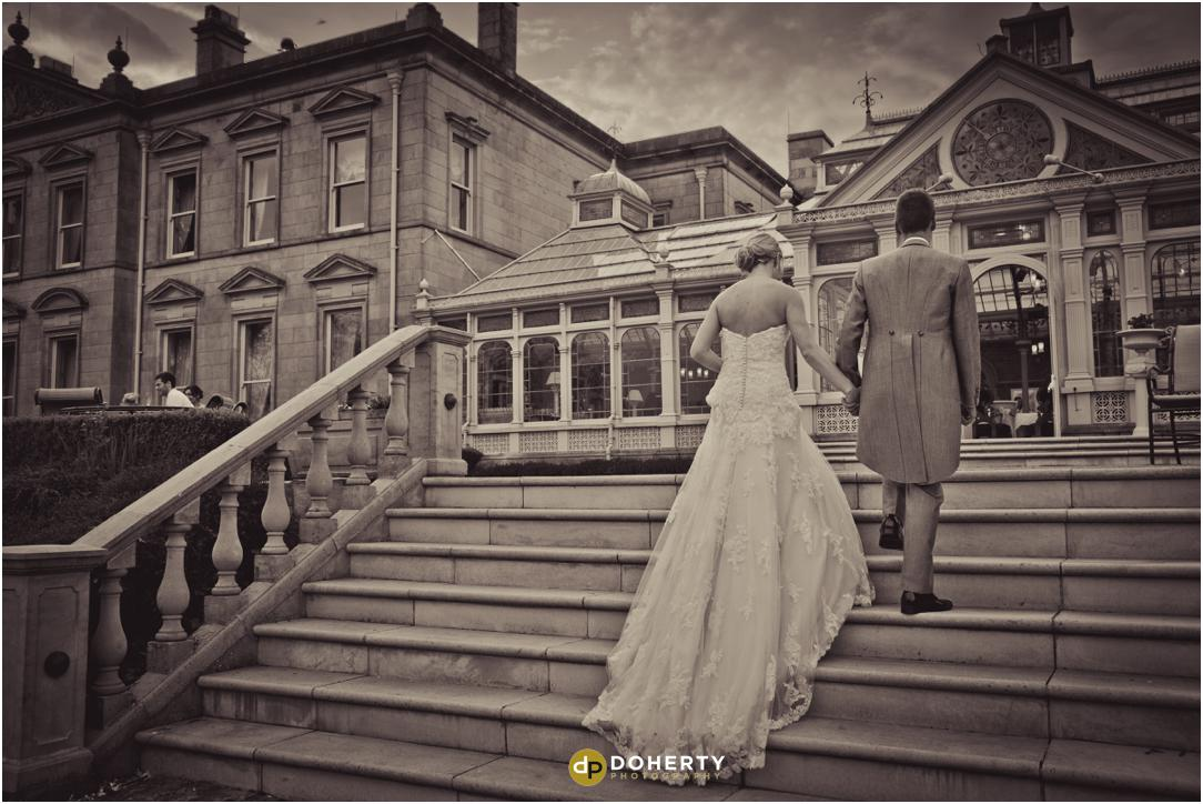 Bride and Groom on steps at Kilworth House