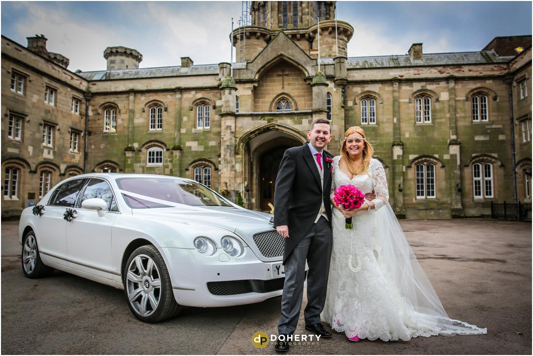 Studley Castle with bride and groom and car