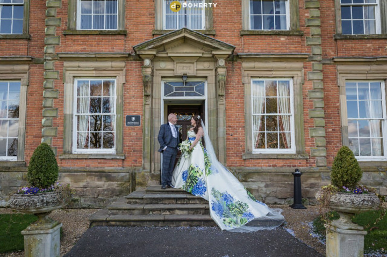 Ansty Hall with bride and groom at entrance