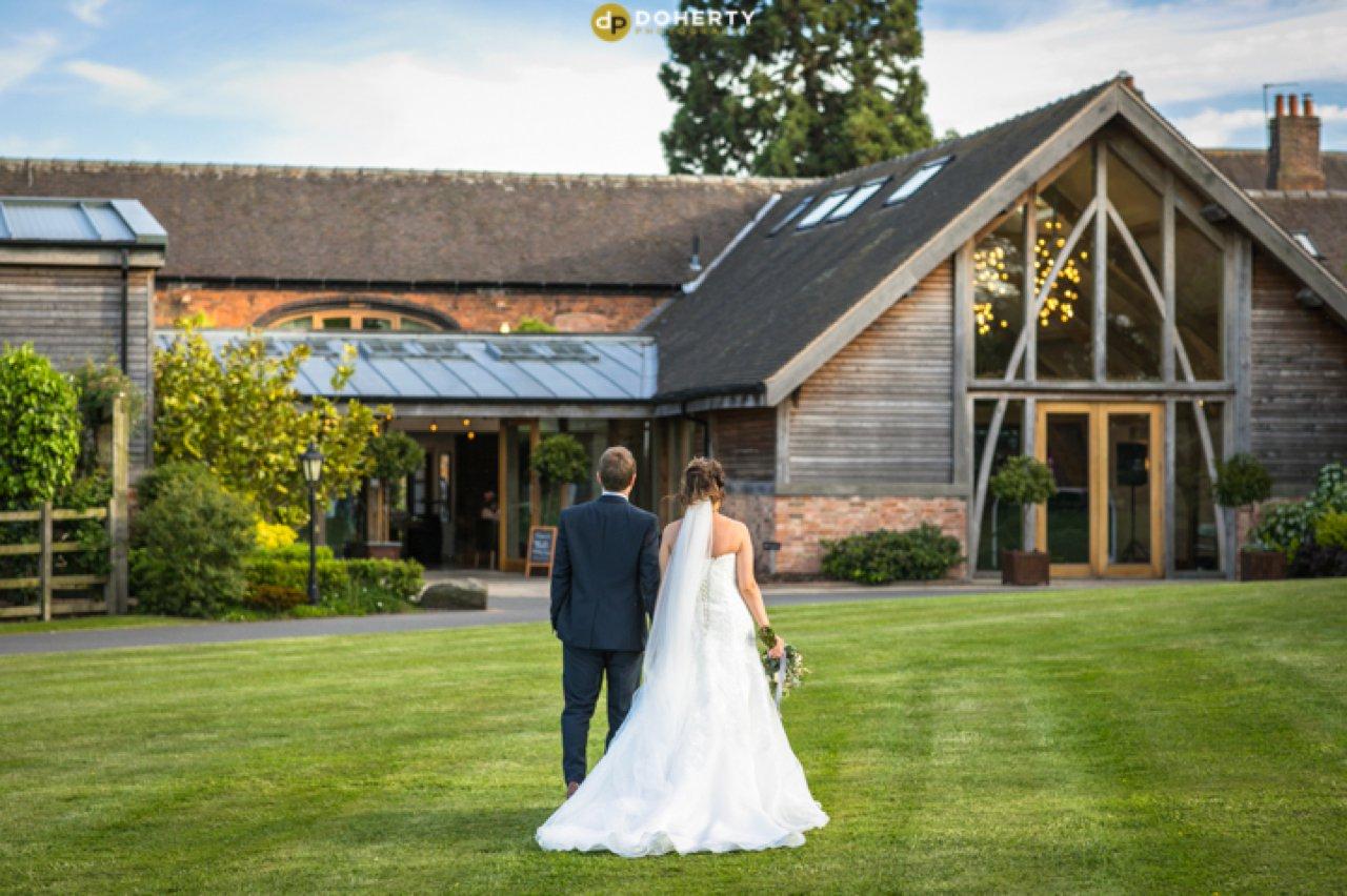 Mythe barn Bride and Groom on Gardens