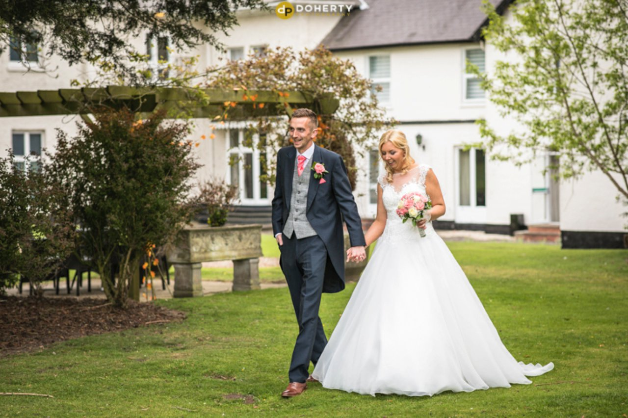 Brandon Hall Bride and Groom Walking in Gardens