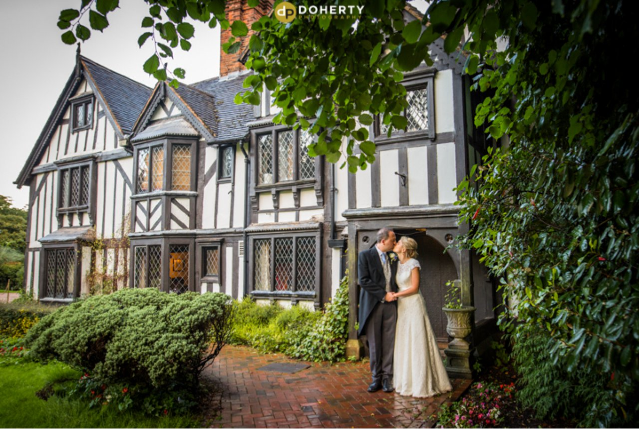 Nailcote Hall Bride and Groom outside Manor House