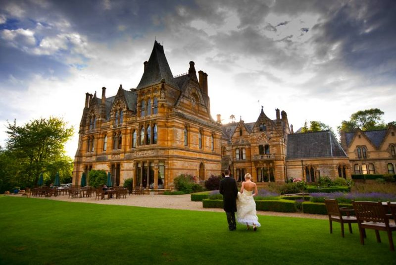 Ettington Park Backdrop of building with bride and groom