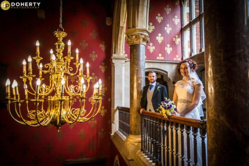 Brownsover hall Bride and Groom by Chandelier