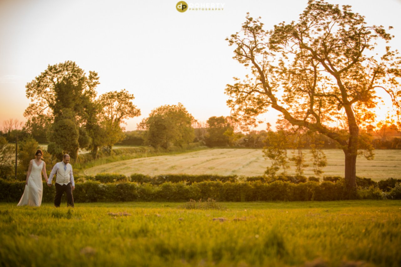 Plum Park Bride and Groom in fields