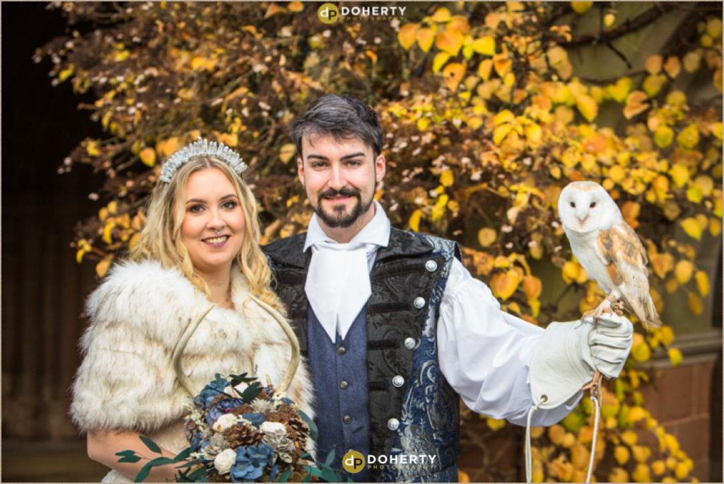 Bride and Groom holding an Owl at Coombe Abbey - Medieval Themed Wedding