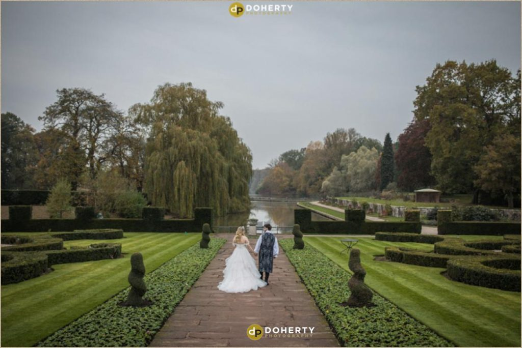 Bride and Groom walking in Gardens at Coombe Abbey