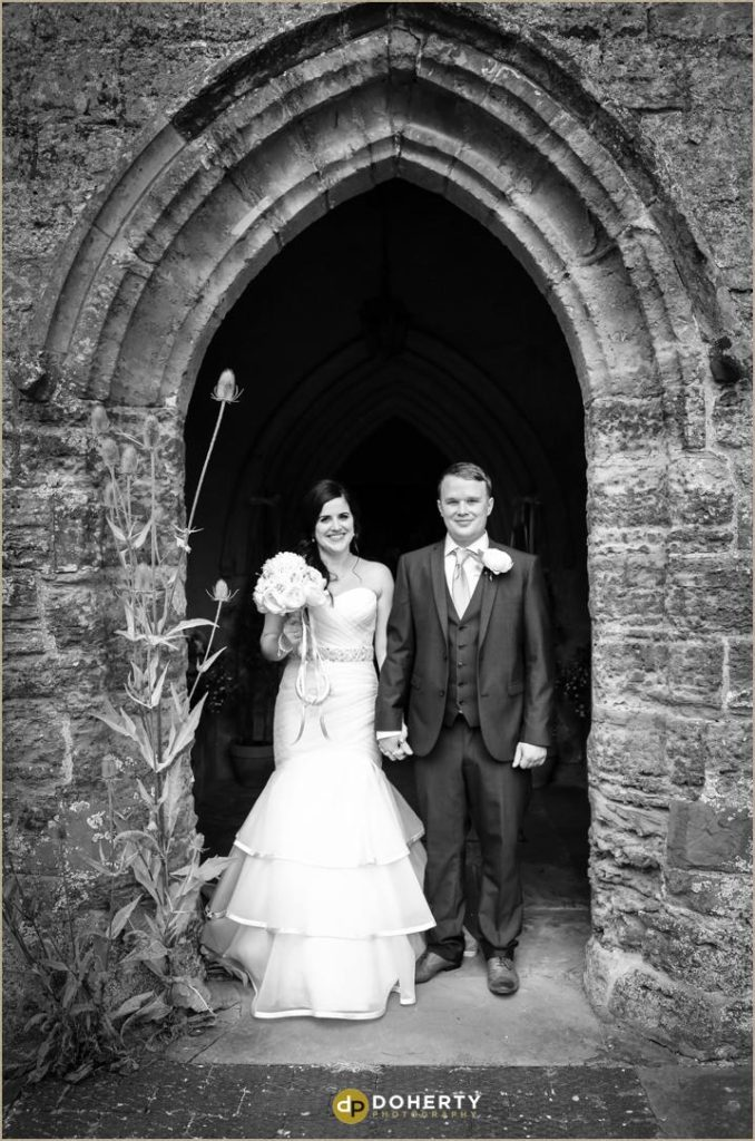 Bride and Groom outside St Peter's church
