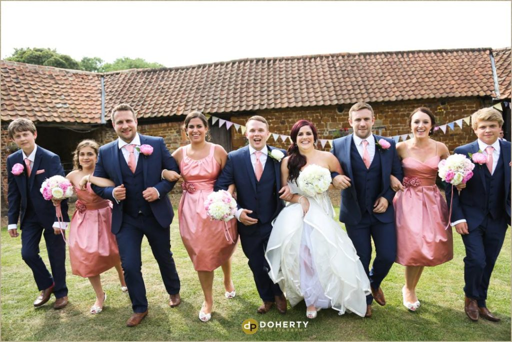 Bridal Party running at The Barns at Hunsbury Hill Wedding