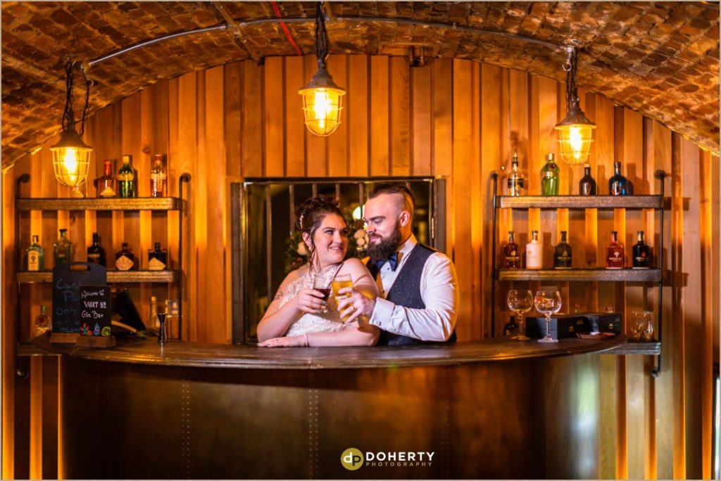 Bride and Groom behind the bar at the Vault - Windmill Village Hotel - Winter Wedding