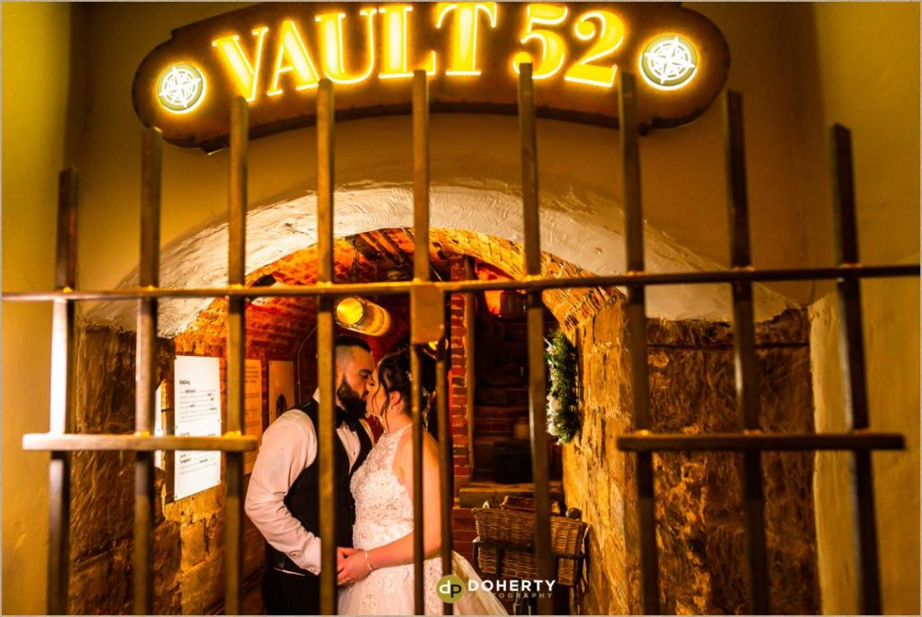 Bride and Groom locked in the Vault 52 at Windmill Village Hotel Wedding