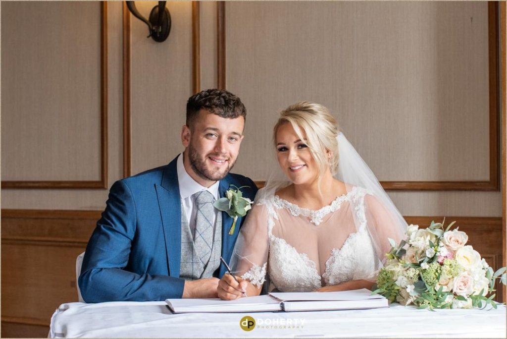 Wedding registrar signing - Manor Hotel Meriden