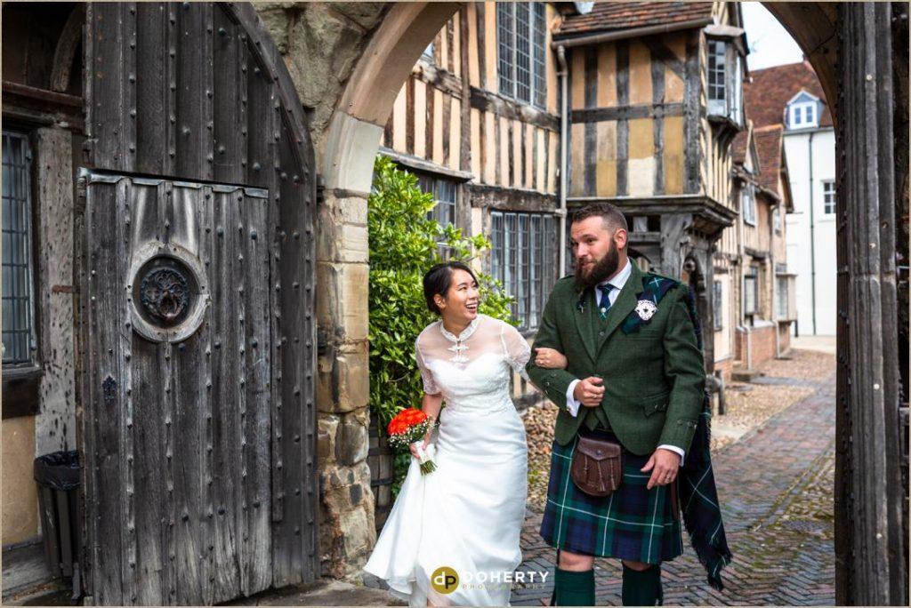 Bride and Groom arrive at Lord Leycester Hospital wedding venue