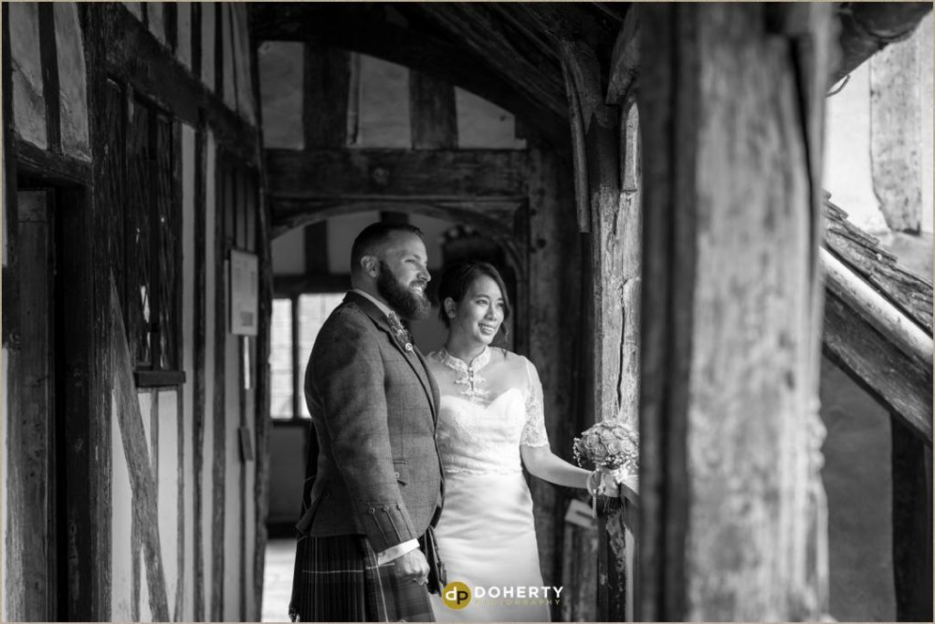 Black and white photo of wedding couple at Lord Leycester in Warwick