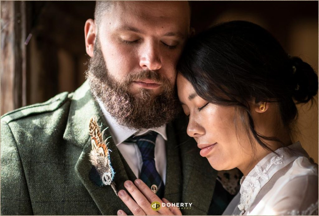 Closeup of bride and groom at Lord Leycester Hospital