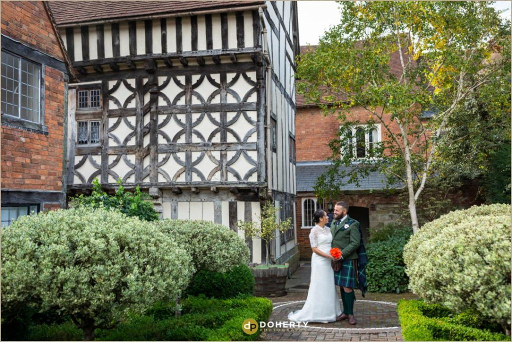 Bride and Groom in gardens at Lord Leycester